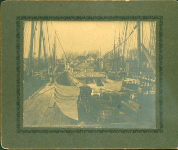 Wharf, ships, dories and cod drying